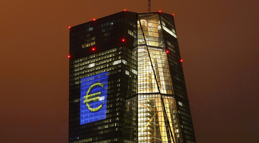 """The headquarters of the European Central Bank (ECB) are illuminated with a giant euro sign at the start of the """"Luminale, light and building"""" event in Frankfurt © Kai Pfaffenbach"""
