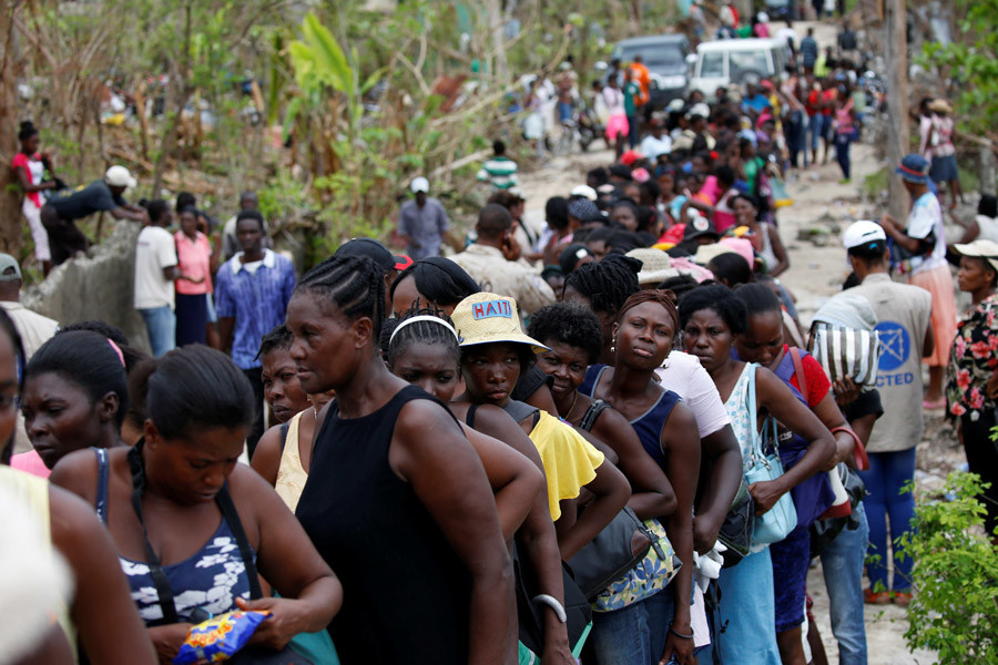People line up for food to be handed out after Hurricane Matthew hit Jeremie, Haiti, October 19, 2016. © Carlos Garcia Rawlins