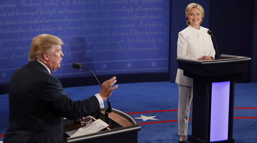 Republican U.S. presidential nominee Donald Trump speaks as Democratic U.S. presidential nominee Hillary Clinton listens during their third and final 2016 presidential campaign debate at UNLV in Las Vegas, Nevada, U.S., October 19, 2016. © Mark Ralston