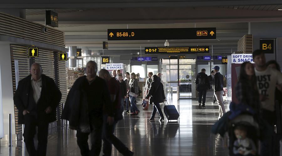 Passengers walk to their gates at Riga International airport, Latvia © Ints Kalnins