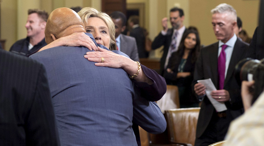U.S. Democratic presidential candidate Hillary Clinton hugs U.S. Representative Elijah Cummings (D-MD)(C, back to camera). File photo. © Joshua Roberts