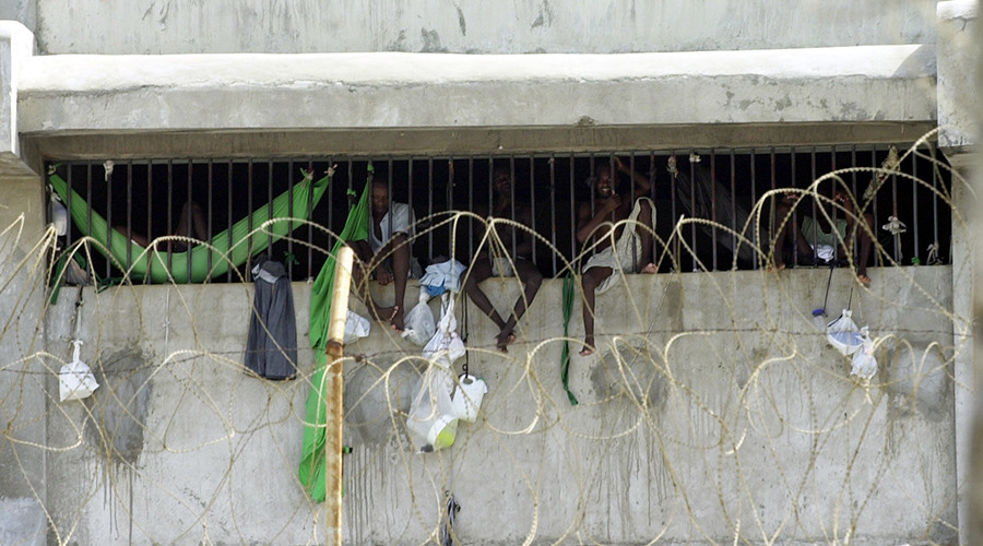 Big prison break: 174 inmates kill guard, steal guns, flee Haiti prison