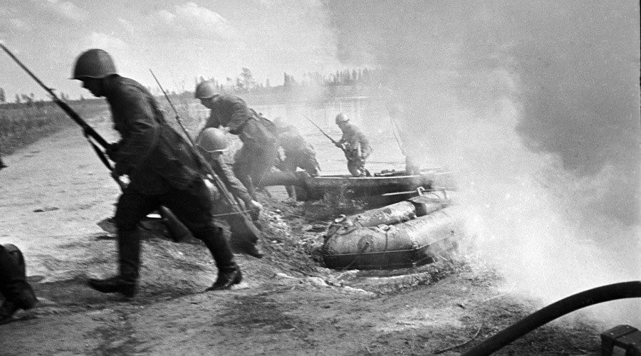 Soviet soldiers crossing a river. The North-Western Front. © Peter
