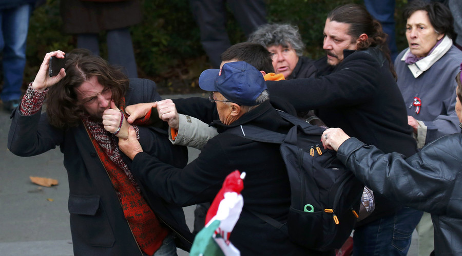 Pro- and anti-government supporters scuffle near a ceremony marking the 60th anniversary of 1956 anti-Communist uprising in Budapest, Hungary, October 23, 2016. © Laszlo Balogh
