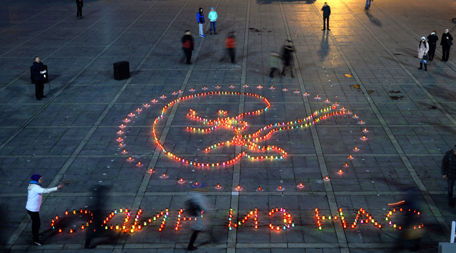 """Protest against abortion """"One of Us"""" on Plotinka in Yekaterinburg. 600 lamps placed by protesters form a silhouette of a 12-week fetus in the womb. © Pavel Lisitsyn"""