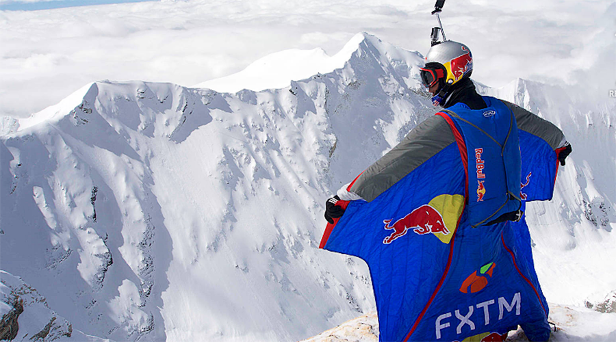 Russian smashes base jumping record with Tibetan mountain leap (VIDEO)