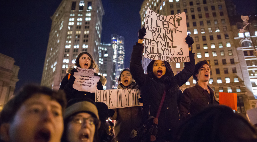 Protesters, demanding justice for Eric Garner, hold placards while shouting slogans in Foley Square, New York December 4, 2014. © Elizabeth Shafiroff