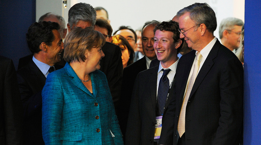 FILE PHOTO: German Chancellor Angela Merkel speaks with Facebook founder and Chief Executive Officer Mark Zuckerberg (C) and Google CEO Eric Schmidt (R) at the G8 Summit in Deauville May 26, 2011 © Philippe Wojazer
