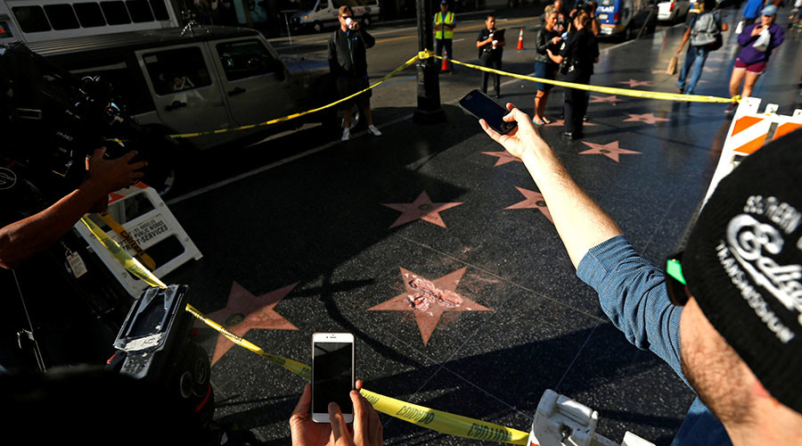 Trump's Walk of Fame star smashed with a sledgehammer (VIDEO)