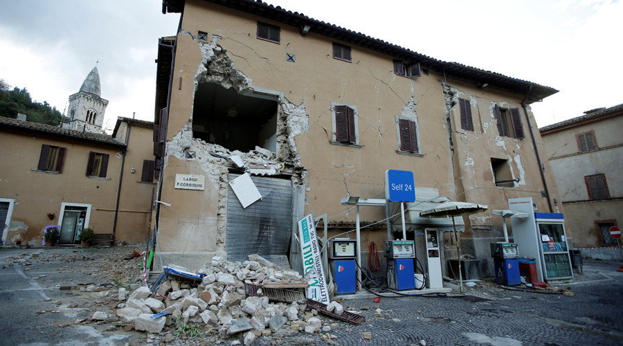 A collapsed building is seen next to a petrol station after an earthquake in Visso, central Italy, October 27, 2016. © Max Rossi
