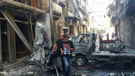 FILE PHOTO Residents in Midan, a Christian district of Aleppo, hit by mortar shelling. © Mikhail Alayeddin