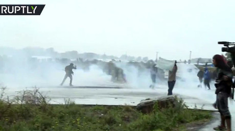 Tear gas, water cannon used in Calais as pro-migrant rally attempts to proceed amid ban