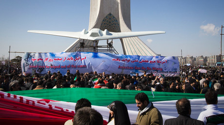 A scale model of the US RQ-170 unmanned spy plane is displayed during a ceremony to mark the 33rd anniversary of the Islamic Revolution, in Tehran's Azadi square February 11, 2012. © Raheb Homavandi