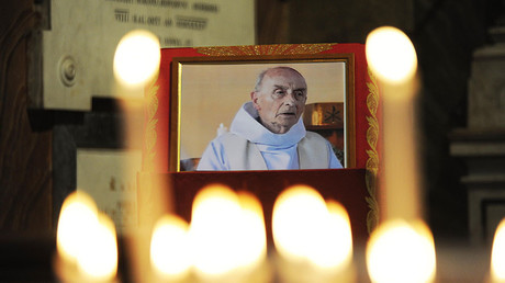 This file photo taken on August 17, 2016 shows a picture of slain Father Jacques Hamel inside the church of San Luigi dei Francesi in downtown on August 17, 2016. ©Marco Zeppetella