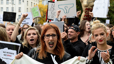 Polish women take part in a nationwide strike and demonstration to protest against a legislative proposal for a total ban of abortion on October 3, 2016 in Warsaw. © Janek Skarzynski