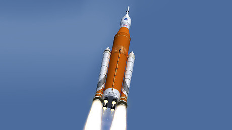 An artist's rendition of NASA's Space Launch System rocket in its latest configuration following its Critical Design Review. ©NASA