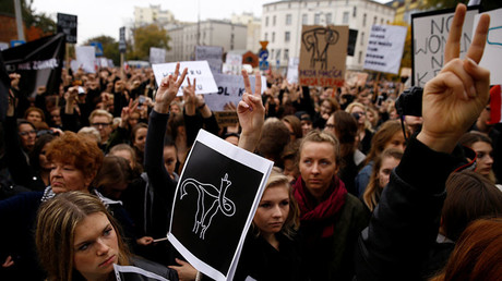 Women gesture as people gather in an abortion rights campaigners' demonstration to protest against plans for a total ban on abortion in front of the ruling party Law and Justice (PiS) headquarters in Warsaw, Poland October 3, 2016. © Kacper Pempel