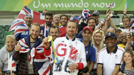 Bradley Wiggins (GBR) of Britain holds his gold medal and poses with supporters. © Matthew Childs