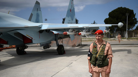 A Russian serviceman near a Su-30 fighter aircraft at the Hmeimim airbase in Syria. © Maksim Blinov