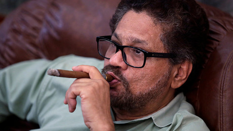 Revolutionary Armed Forces of Colombia (FARC) lead negotiator Ivan Marquez smokes a Cohiba cigar while watching a live transmission of the referendum on a peace deal, in Havana, Cuba October 2, 2016 © Enrique de la Osa