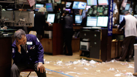 A trader sits down, on the floor of the New York Stock Exchange © Brendan McDermid