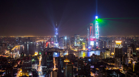 Light and laser illuminate the Lujiazui financial district of Pudong in Shanghai © Aly Song