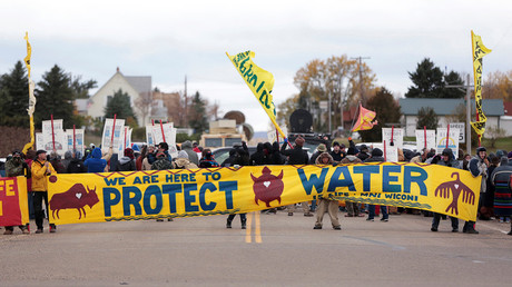 Dakota Access Pipeline protesters square off against police between the Standing Rock Reservation and the pipeline route outside the little town of Saint Anthony, North Dakota, U.S., October 5, 2016. © Terray Sylvester