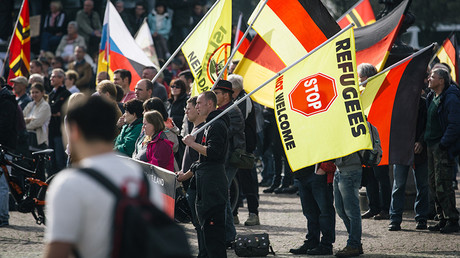 Supporters of the anti-immigrant Pegida movement mark the second year of existence as they demonstrate in Dresden, eastern Germany, on October 2016 © Oliver Killig