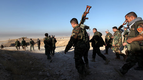 Peshmerga forces walk in the east of Mosul during operation to attack Islamic State militants in Mosul, Iraq, October 17, 2016. © Azad Lashkari