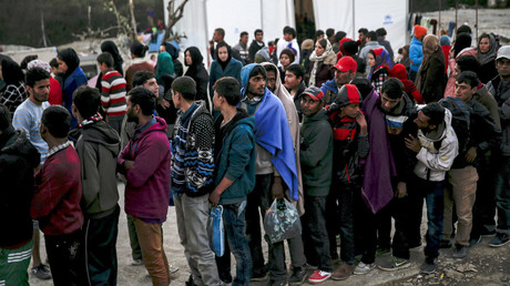 Refugees and migrants line up for a food distribution at the Moria refugee camp on the Greek island of Lesbos © Alkis Konstantinidis