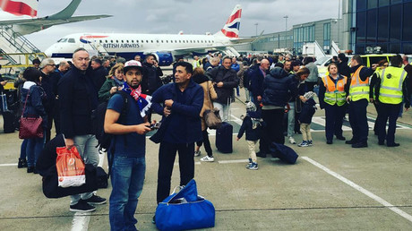 Travellers were evacuated onto the tarmac. © icicle_music