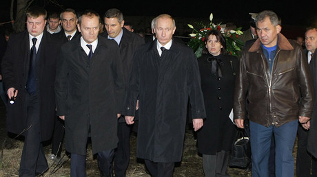FILE PHOTO: Russian Prime Minister Vladimir Putin and Polish Prime Minister Donald Tusk visiting Polish president's Tu-154 plane crash site outside Smolensk on April 10, 2010 © Aleksey Nikolsky