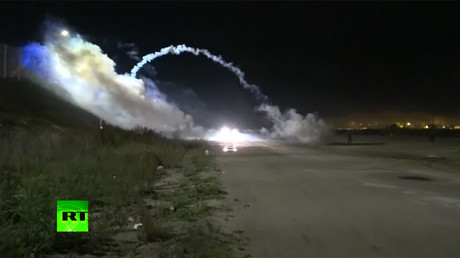 French police fire teargas at Calais migrants