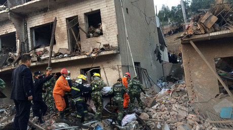 Rescue workers search at site after an explosion hit a town in Fugu county, Shaanxi province, China, October 24, 2016. © China Daily