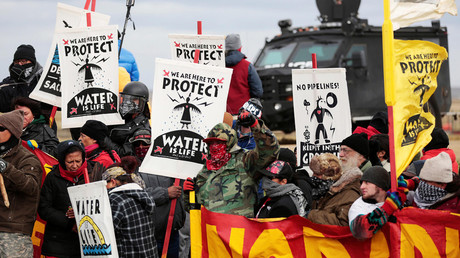 Dakota Access Pipeline protesters square off against police near the Standing Rock Reservation and the pipeline route outside the little town of Saint Anthony, North Dakota, U.S., October 5, 2016. © Terray Sylvester