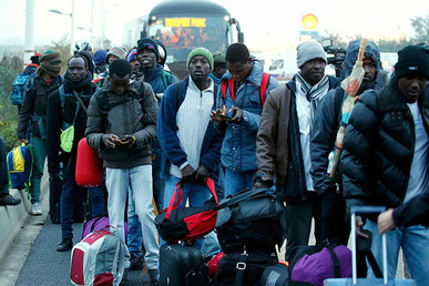 Migrants with belongings queue near buses during evacuation and transfer to reception centers in France, Calais, France, October 24, 2016. © Pascal Rossignol
