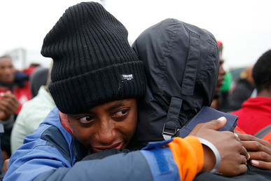 "An Ethiopian migrant, member of the Oromo community, cries as he leaves the ""Jungle"" to be transferred to reception centers during the ""Jungle's"" dismantlement, in Calais, France, October 24, 2016. © Pascal Rossignol"