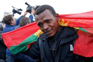 "An Ethiopian migrant, member of the Oromo community, cries as he leaves the ""Jungle"" to be transferred to reception centers during the start of the dismantlement of the camp in Calais, France, October 24, 2016. © Pascal Rossignol"