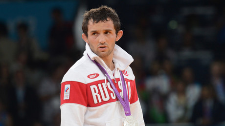 Russia's Besik Kudukhov, silver medalist in the men's 60 kg freestyle wrestling at the 2012 Olympic Games in London, receiving his medal at the award ceremony. © Vladimir Baranov