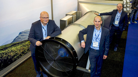 (From L) the group's Managing Partners Peter van Wees, Simon van der Burg and Tim Petter posing next to a system created by van Wees to filter fine and ultra-fine particles from ambient air at the Offshore Energy 2016 Exhibition & Conference in Amsterdam on October 25, 2016 © Menno Ringnalden