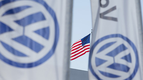 An American flag flies next to a Volkswagen car dealership in San Diego, California © Mike Blake