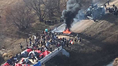 Protestors against the Dakota Access Pipeline stand-off with police in this aerial photo of Highway 1806 and County Road 134 near the town of Cannon Ball, North Dakota, U.S., October 27, 2016. © Morton County Sheriff's Office