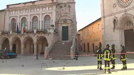 This handout TV grab released by Italian broadcast Sky Tg24 shows firefighters in front of the basilica of Norcia (R) and the town hall (L) after an 6.6 magnitude earthquake on October 30, 2016 in Norcia © HO