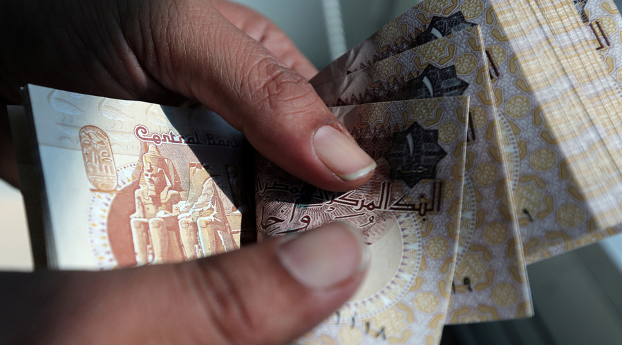 Egypt devalues currency to spur economy and meet IMF loan demand