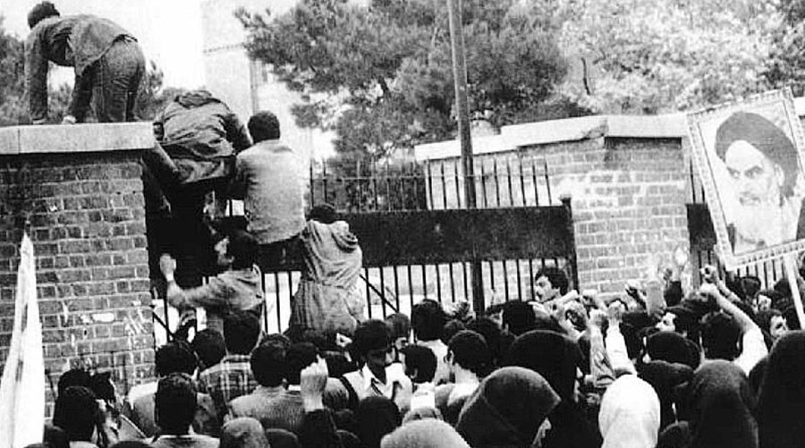 Iranian students scale the wall of the embassy at the start of the siege  © Wikipedia