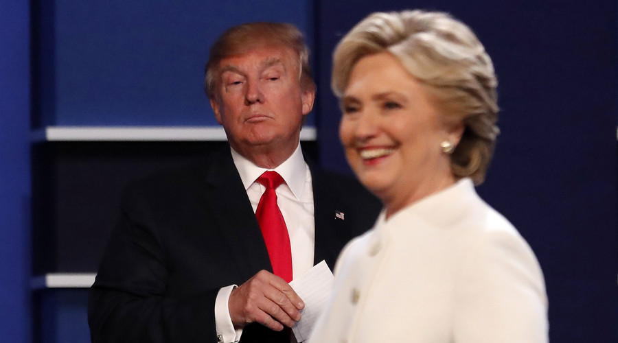 Republican U.S. presidential nominee Donald Trump and Democratic U.S. presidential nominee Hillary Clinton finish their third and final 2016 presidential campaign debate at UNLV in Las Vegas, Nevada, U.S., October 19, 2016. © Mike Blake