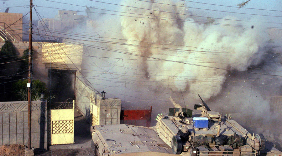 An M1A1 Abrams tank with the 2nd Tank Battalion returns fires into a building after U.S. Marines came under attack in Falluja, in this handout photo released December 16, 2004. ©