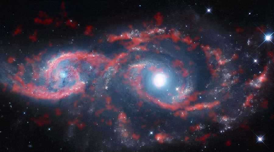 'Tsunami of stars & gas': Galaxies collide in whirling mass of space debris (PHOTOS)