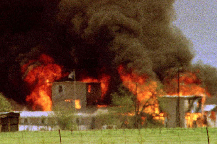 The Davidians' Mount Carmel compound near Waco, Texas, is shown engulfed in flames in this April 19, 1993 file photo. ©Reuters