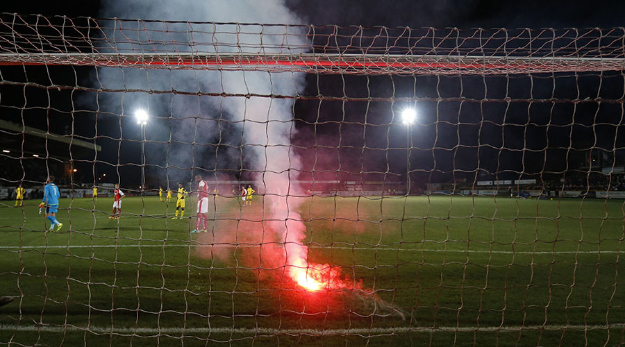 Flares thrown by English football fans miss players by inches during FA Cup tie (VIDEO)